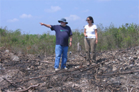 Turner (left) and student setting up a transect to examine deforestation in southern Yucatan
