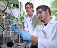 Environmental Biology research scientists setting up experiments with a microbial fuel cell