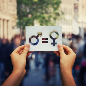Person holding gender equality sign