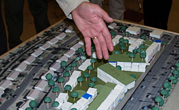 Hand pointing to housing models