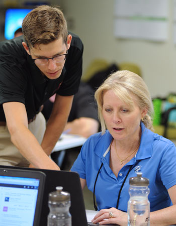 An Academy mentor helping one of the summer 2015 National Sustainability Teacher's Academy participants