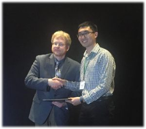 Qunshan Zhao recieving award