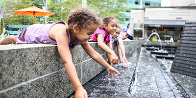 african-american-girls-playing-in-a-fountain