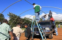 Constructing Greenhouses in the Waimea Nui Community.