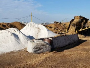 Pile of gypsum next to compost heap