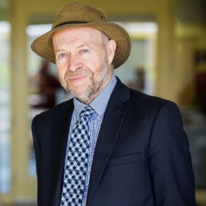 james hansen wearing brown hat and navy blazer