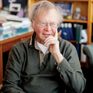 Climate change expert Wally Broecker smiling in study full of books