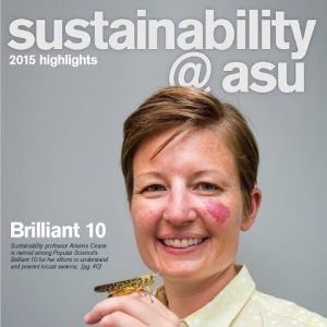 ASU sustainability professor Arianne Cease holds a locust on her hand and smiles