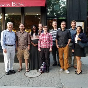 Eight School of Sustainability pose with Dean Boone outside of a D.C. restaurant