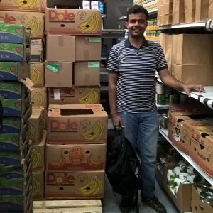 Student standing in food bank pantry