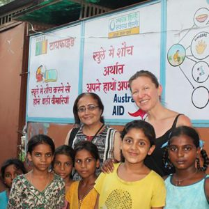 Professors smile with a group of school girls in Delhi