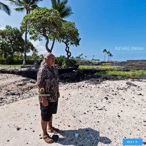 Guide stands in the center of a Hawaiian cultural landmark