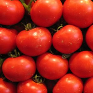 A crate of ripe red tomatoes