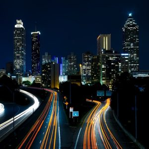 Night view of Atlanta, GA with light streams left by highway cars