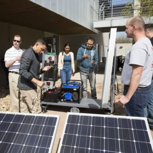 Students assemble solar panels at the ASU Poly campus