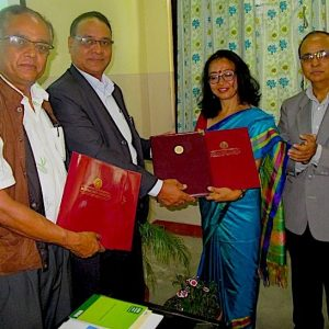Nalini Chhetri holds signed MOU with three other men in Nepal.