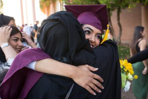 Graduate hugging parent at convocation
