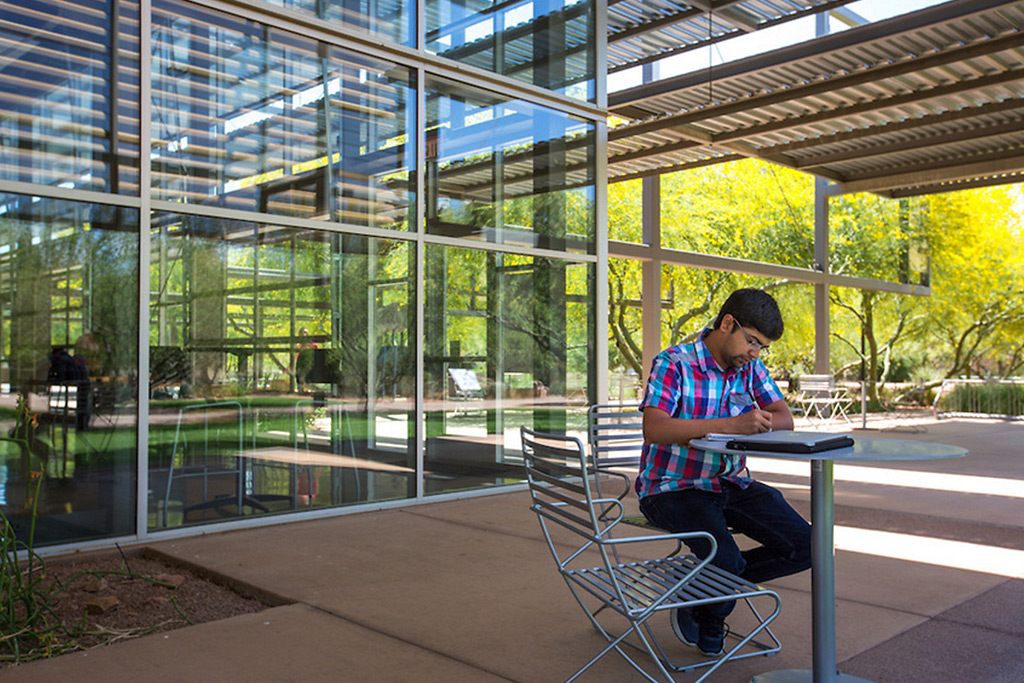Student studying outdoors at Polytechnic campus