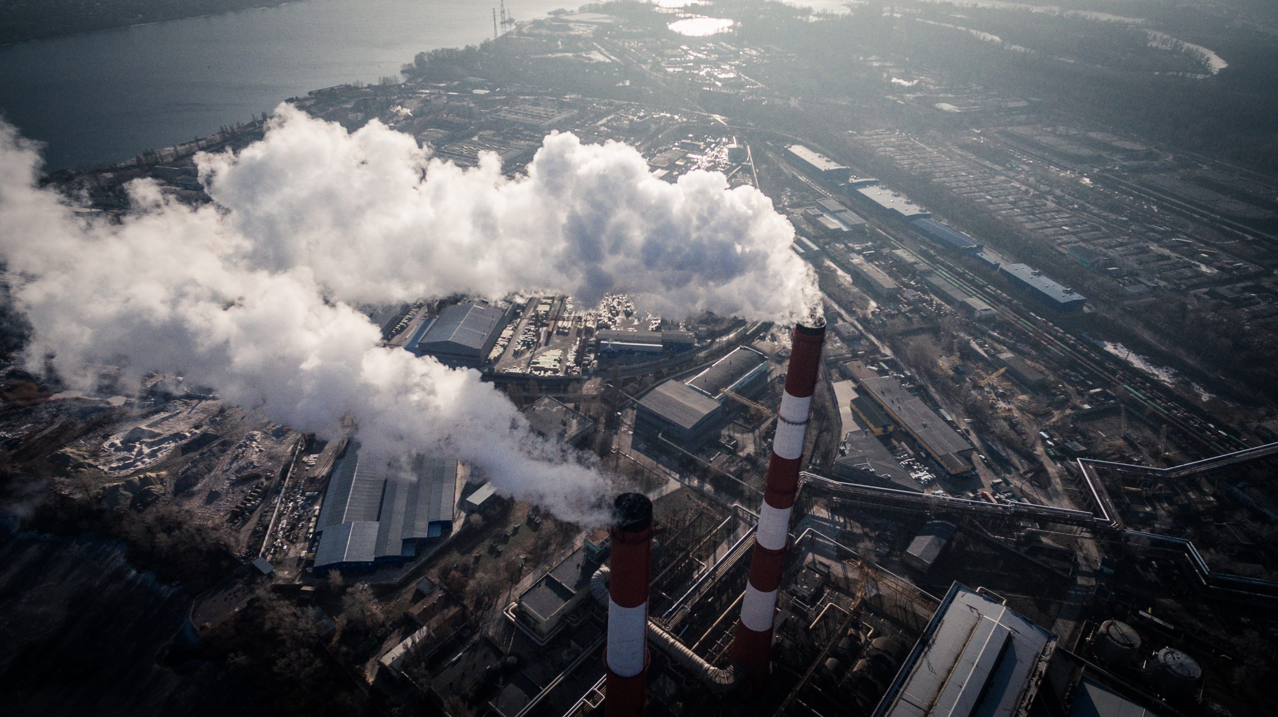 aerial view of smokestacks spewing smoke into the air